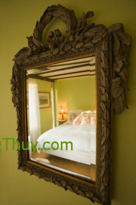 Reflection of bed in mirror --- Image by © Scott Barrow/Corbis